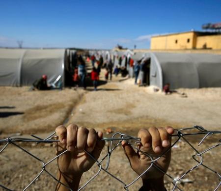 Koerdische vluchteling in vluchtelingenkamp in Suruc © REUTERS/Yannis Behrakis