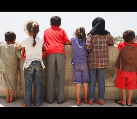 de tienjarige 'Ibrahim' met zijn broers en zusjes