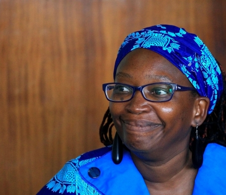 Ugandan prominent academic Stella Nyanzi smiles as she appears at Buganda Road court charged with cybercrimes after she posted profanity-filled denunciations of president Yoweri Museveni on Facebook, in Kampala, Uganda April 25, 2017. REUTERS/James Akena