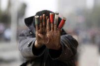 Egyptische demonstrant toont kogelhulzen gebruikt door de politie - © REUTERS